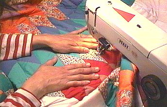 Polly quilting the layers together